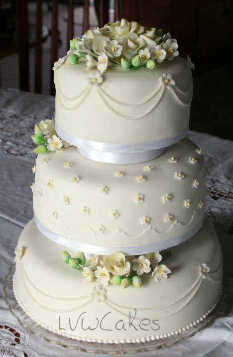 Three Tiers With Sugar Roses And Freesia